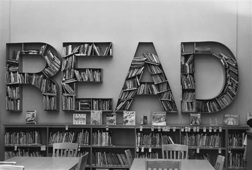 "Picture of word ""READ"" filled with library books"